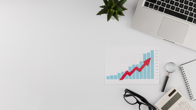 top-view-office-desk-with-growth-chart-copy-space_23-2148780606